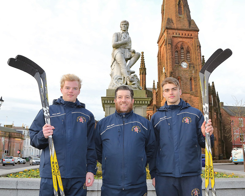 GB U20s players Stuart Kerr (left) and Jordan Buesa (right) either side of assistant coach Martin Grubb in front of the Robert Burns Statue in Dumfries.